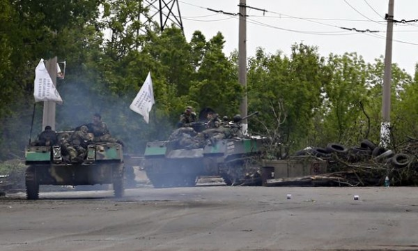 Pro-Russia gunmen on armored personal carriers
