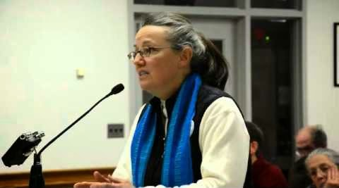 Mary Anne Grady Flores wearing the blue scarf in court