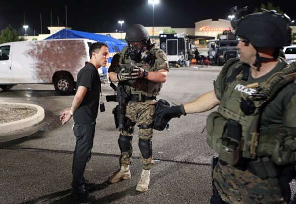 The author, detained by a St. Louis County Police Department tactical team Tuesday morning, explains to an officer how to turn off his digital recorder. Photo: David Carson/St Louis Post Dispatch/Polaris